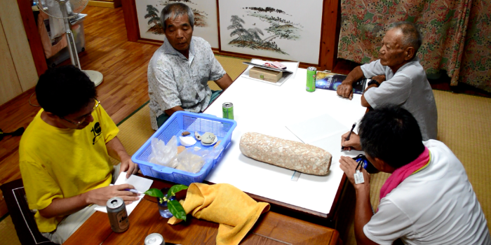 Randall Sasaki (Kyushu National Museum, front left), and Professor Ikeda (Ryukyu University, front right), interviewing members of the local community on Tarama Island, Japan, 2016 (photo: RCE)
